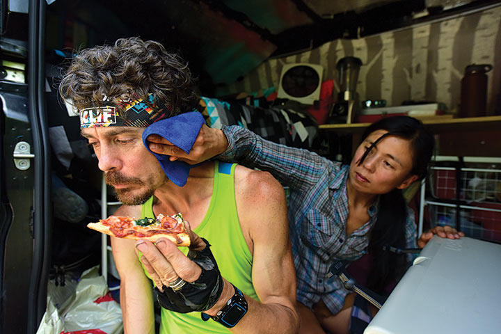 Scott Jurek eating vegan pizza during a break on the Appalachian Trail