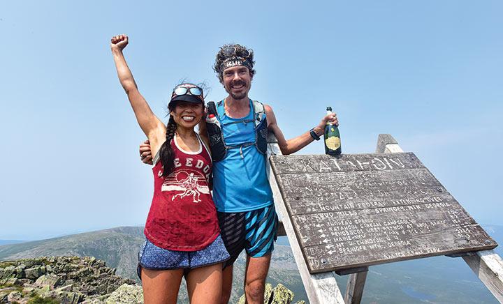 Scott and Jenny Jurek celebrate with champagne at Mount Katahdin, the Appalachian Trail's end.