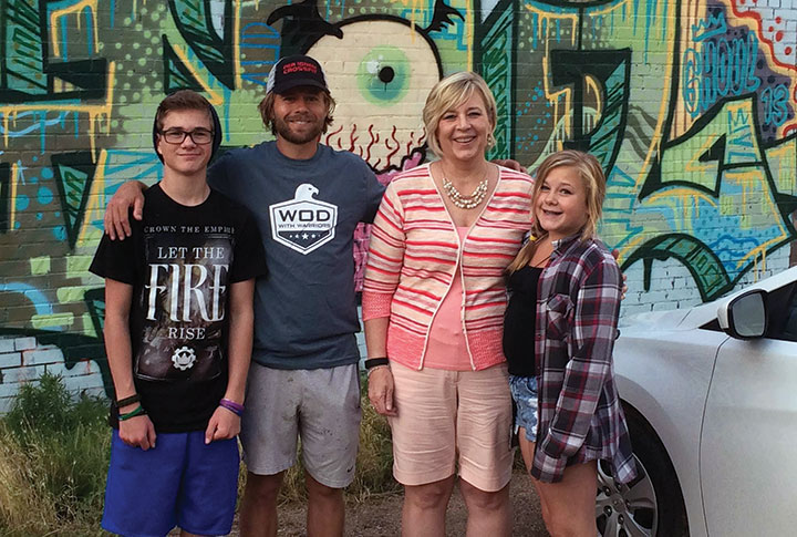 Chad Prichard with his son, Tanner, then 15; his mother, LuAnn Nichols; and his daughter, Madison, 13, outside of Phoenix Multisport in Denver in June 2015.