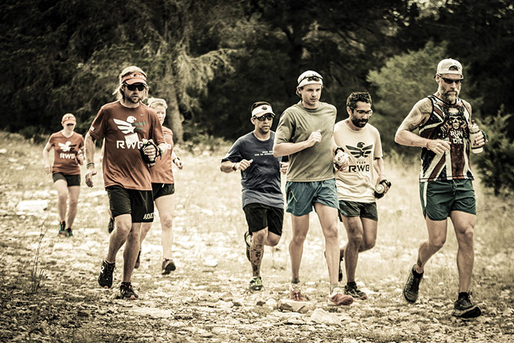 Chad Prichard (left, foreground) practices trail running and builds friendships at the Team RWB trail-running camp near Rock Springs, Texas, October 2015.