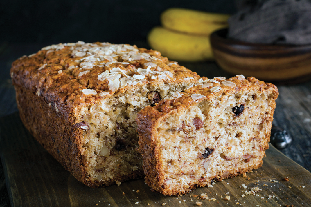 Cut banana bread with crumbs.